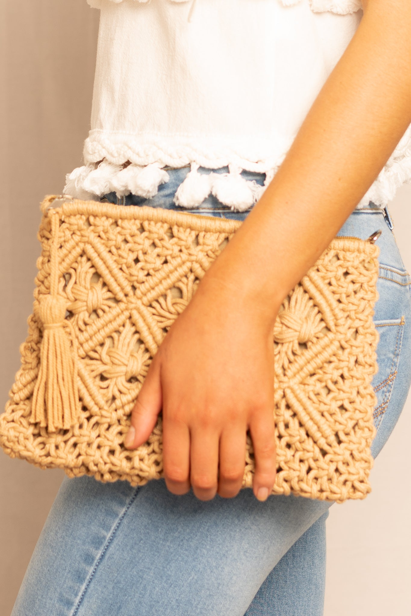 brown woven clutch