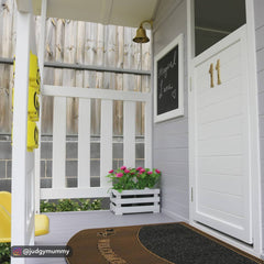 image of a kids cubby house with a door matt