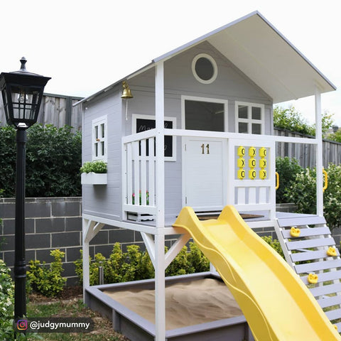 photo of a double story cubby house for sale and a sandpit underneath