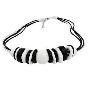 necklace various beads and rings black-white black and white cord