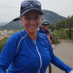 Laura cycling with SOLBARI Sun Protection Clothing