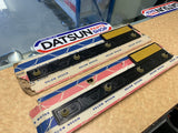 Datsun 1600 Guard Badge Pair to Suit Datsun 720 Genuine New Old Stock
