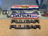 Datsun N10 Pulsar 1/4 Badges New Old Stock Pair
