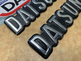 Datsun 200B 810 1/4 Panel Badge Pair Used