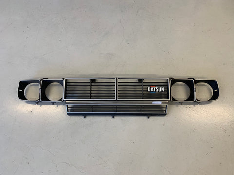 Datsun 200B Late Grill Set with Head Light Surrounds Used 810