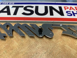 Datsun 1200 Badge