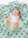 Little Robin - Organic cotton muslin swaddle blanket - Baby on swaddle - Little Blue Nest