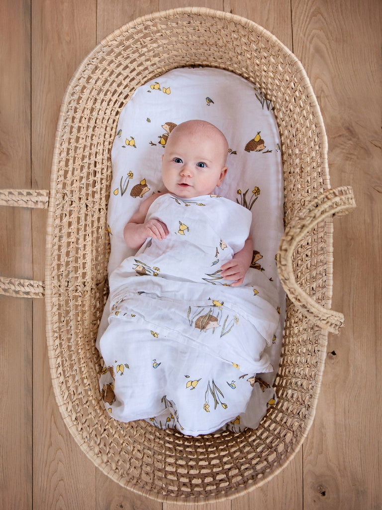 Cotton muslin swaddle blanket in moses basket woodland hedgehog