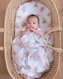 Organic cotton muslin swaddling blanket Peach blossom in moses basket