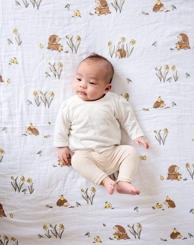 Cotton muslin swaddle blanket used as play mat