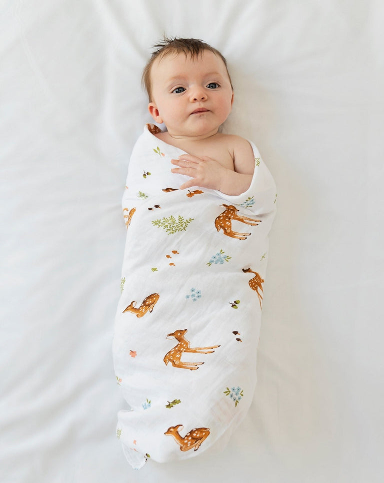 Baby swaddled fawn muslin blanket