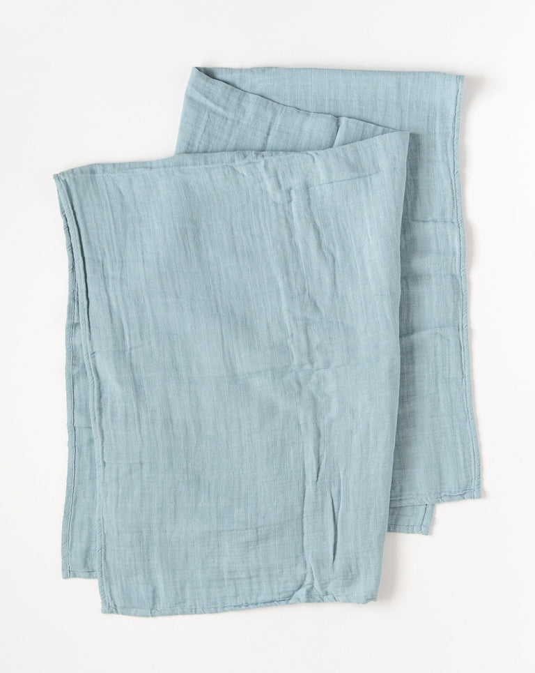 Blue organic muslin swaddle blanket folded