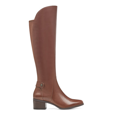 Embrace a modern silhouette that's sure to garner plenty of compliments with Anne Klein smooth leather Jela boot. Jela has a pull-on design with a half-zip closure at the side and a stretch panel at the back for added comfort. Jela's insole has dual, lightweight foam layers to provide cushioning and shock-absorption as well as a durable rubber outsole