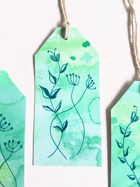 Hand made in Melbourne Australia, gift tag sets with green floral designs.