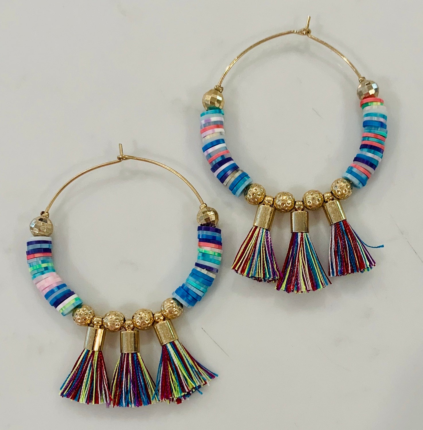 Earrings: rainbow tassel hoop
