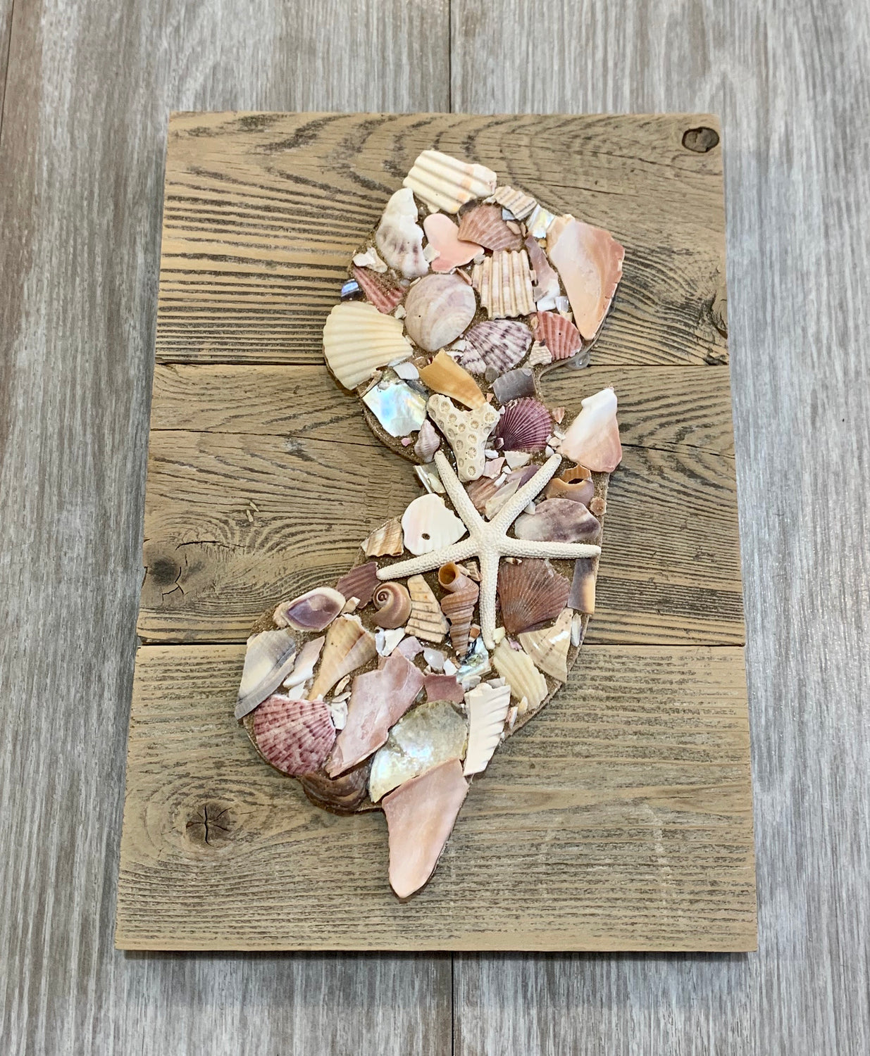 State of NJ in shells on rustic wood