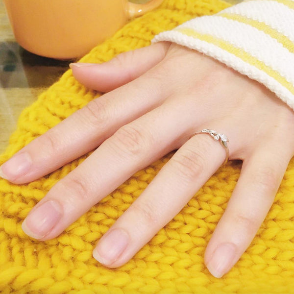 Engagement Ring from 2017 with hand on a yellow knitted hat