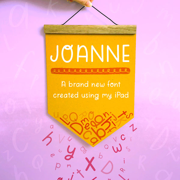 The font 'Joanne' that was created using an ipad set on a yellow banner flag on a purple background with pink letters falling off.