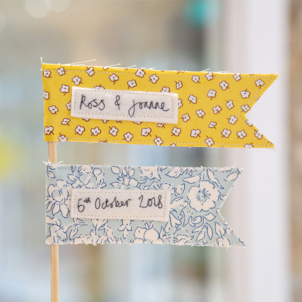 Custom yellow and blue cake topper by Jane Kent