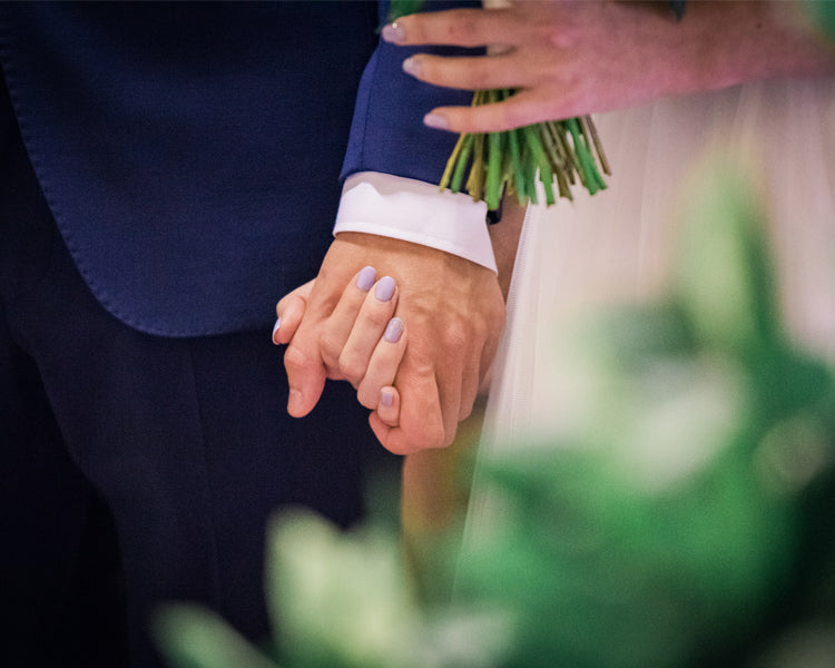 Holding hands after the exchange of the rings