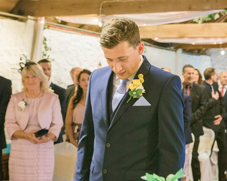 Ross nervously waiting at the end of the aisle with his mum smiling at him