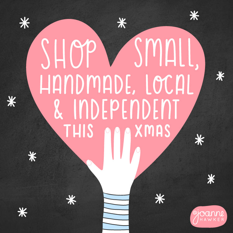 Shop small, handmade, local and independent this Christmas blog graphic featuring a hand holding up a pink heart with the shop small text in the centre. The image is laid up on a chalk background with white snow flakes.