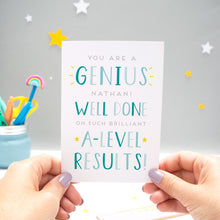 Load image into Gallery viewer, 'You are a genius [insert name]! Well done on such brilliant A-Level results'. A personalised exam congratulations card featuring my hand drawn letters in varying shades of blue, and with yellow stars.