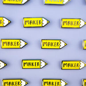 Yellow Pencil 'Maker' hard enamel pins all in a line