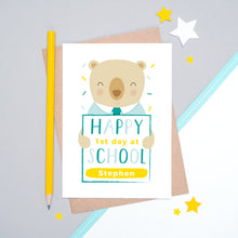 Load image into Gallery viewer, A happy 1st day at school personalised card featuring a friendly bear sat on a grey and white background.