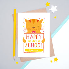 Load image into Gallery viewer, A happy 1st day at school personalised card featuring a friendly orange cat sat on a grey and white background.