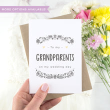 To my grandparents on my wedding day. A white card with grey hand drawn lettering, and a grey floral border. The image features a wedding dress and bouquet of flowers.