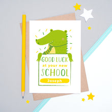 Load image into Gallery viewer, A good luck at your new school personalised card featuring a green friendly crocodile sat on a grey and white background.