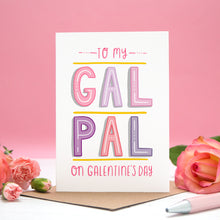 Load image into Gallery viewer, To my Gal Pal on Galentine's Day. A friendship card designed for Valentine's or Galentine's day! The image features my hand lettered card between two roses and on a pink background.