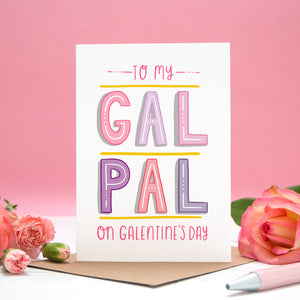 To my Gal Pal on Galentine's Day. A friendship card designed for Valentine's or Galentine's day! The image features my hand lettered card between two roses and on a pink background.