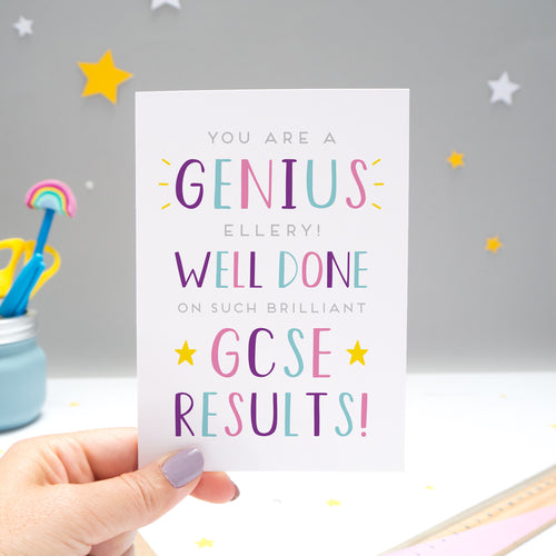'You are a genius [insert name]! Well done on such brilliant GCSE results'. A personalised exam congratulations card featuring my hand drawn letters in varying shades of pink, purple and blue, and yellow stars.
