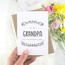 To my grandpa on my wedding day. A white card with grey hand drawn lettering, and a grey floral border. The image features a wedding dress and bouquet of flowers.