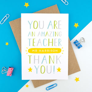 A personalised thank you teacher card that reads 'you are an amazing teacher [insert name of teacher] thank you! In green, blue, grey and a pop of yellow