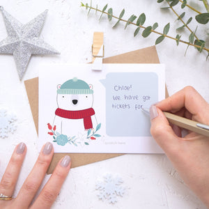 Personalised polar bear secret message Christmas scratch card being hand written.