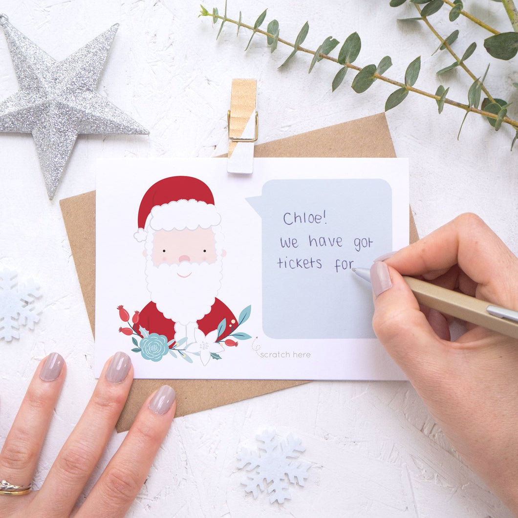 Personalised Santa secret message Christmas scratch card being hand written.