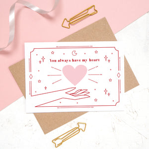 You always have my heart love and romance card designed by Joanne Hawker. This card features the phrase 'you always have my heart' with a heart and cosmic decor.