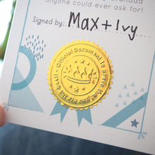 Load image into Gallery viewer, A close up of the gold shiny stamp and the space for the child to sign their signature!