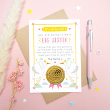 Load image into Gallery viewer, A big sister announcement card from the bump photographed on a pink background with dried flowers, a pen, buttons and stars.
