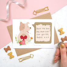 Load image into Gallery viewer, A personalised dog scratch card with a hand written message that has been scratched off. Photographed on a pink and white background with dog biscuits for props.