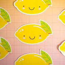 Load image into Gallery viewer, Lemon stickers arranged on a pink and yellow squared background. Only the centre one is shown in full.