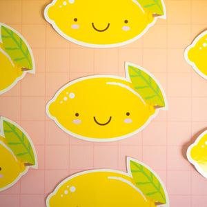 Lemon stickers arranged on a pink and yellow squared background. Only the centre one is shown in full.