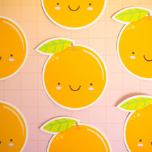Load image into Gallery viewer, Satsuma orange stickers arranged on a pink squared background.