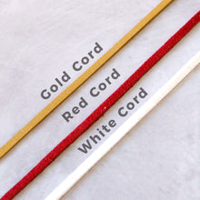 Load image into Gallery viewer, The gold, red and white colour choices for the coloured hanging cord for the personalised christmas decorations.