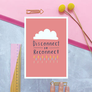 Disconnect to reconnect A5 print in pinky peach and photographed on a pink background with a ruler and yellow flowers