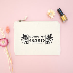 Doing my best cotton accessory pouch in natural with the black text and florals. Photographed on a pink background with dried flowers and gold nail varnish.