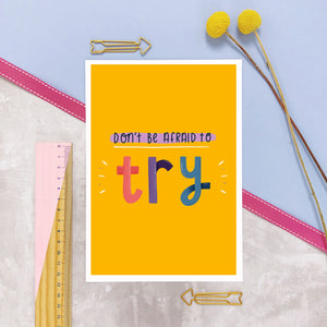 Don't be afraid to try A5 yellow print photographed on a marble and lilac background